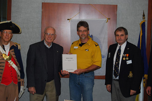 "Pictured here is President Stapleton and MOSSAR Color Guard Comander Robert L. Grover, presenting Historian Brian Smarker with a directory on the Fort Osage Pioneer Cemetery, which is titled ""Sibley (Fort Osage) Pioneer Cemetery 1809-1989"". Compatriot Dexheimer is also shown here, who he and his wife Inez M. Dexheimer, were able to write the directory from his field notes."
