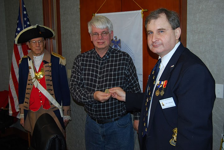 The Harry S. Truman Chapter inducted Compatriot John Mark Skelton into the ranks at the 308th Meeting on Saturday, February 12, 2011. President Dirk A. Stapleton and the Harry S. Truman Chapter Color Guard officiated during the ceremony. President Dirk Stapleton presented Compatriot Skelton with his membership oath and membership certificate.  As Compatriot Skelton's sponsor, Compatriot Robert L. Grover pinned the Membership Rosette on Compatriot Skelton's lapel.