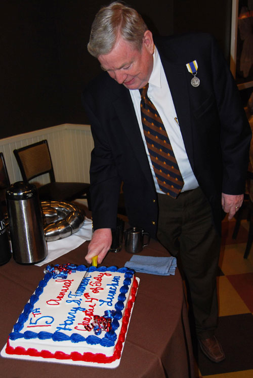 Pictured here is pending new member Dennis Owens, cutting the cake in celebration of the 15th Annual  Harry S. Truman Chapter Fourth of July Luncheon on June 25, 2011, at the Grand Street Cafe in Kansas City, MO.