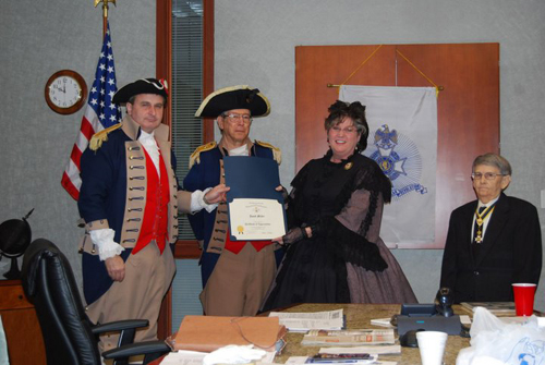 """The Harry S. Truman Chapter Color Guard is shown here presenting a Certificate of Appreciation to Janett Miller of Lee's Summit, MO. Janett Miller, as guest speaker, received this certificate at the 284th Harry S, Truman meeting on January 10, 2009. As the guest speaker, Janett Miller presented a program on the """"The Rose of Arlington; the Life Story of Mrs. Robert E. Lee."""" Janett Miller presents a variety of programs on the history of our country and the women that played important roles in American History."""
