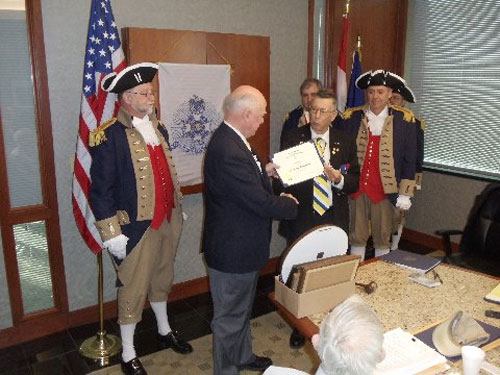 President Robert L. Grover and the Harry S. Truman Color Guard, are shown here presenting a Certificate to guest speaker Compatriot Craig Dillaou, who is from the Monticello Chapter in Kansas. Compatriot Dillaou's topic was on the Secret Service.  The presentation was followed by a question and answer period with Compatriot Dillaou. President Grover presented Compatriot Craig Dillaou with a Certificate of Appreciation and a chapter challenge coin.