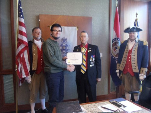 President Robert L. Grover and the Harry S. Truman Color Guard, are shown here presenting a Certificate to guest speaker Mr. Kevin Fewell, President of the Union Cemetery Historical Society.  His topic was on the History of the Union Cemetery. The presentation was followed by a question and answer period with Mr. Fewell. President Grover presented Mr. Fewell with a Certificate of Appreciation and a chapter challenge coin.