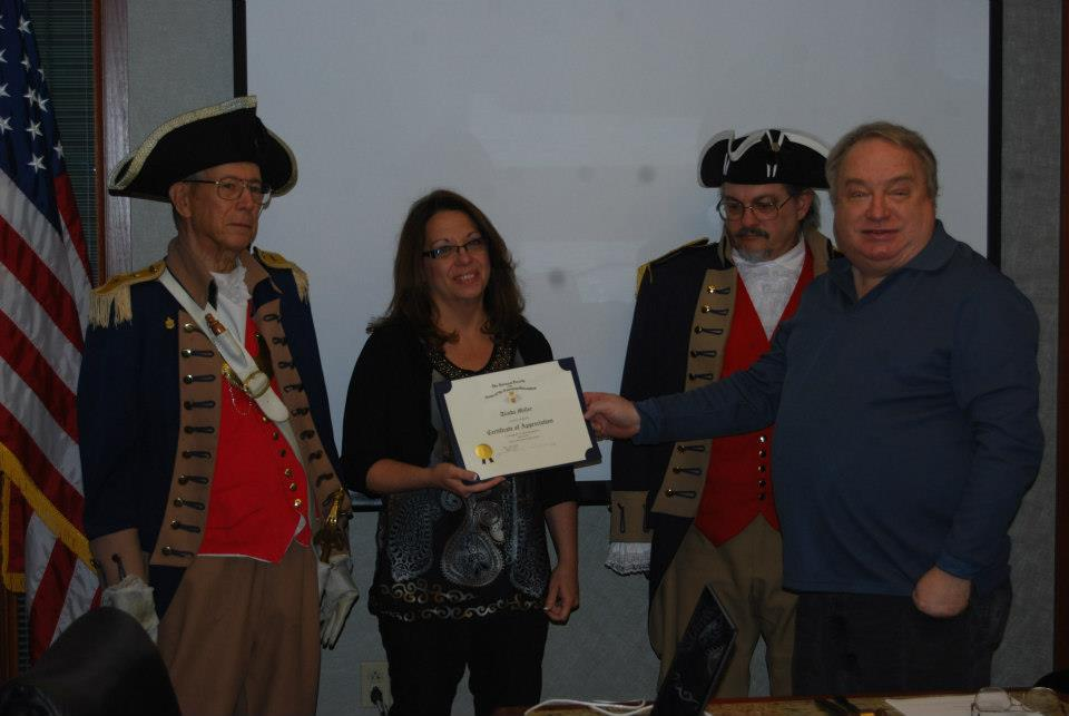 "President Donald Lewis and the Harry S. Truman Color Guard, are shown here presenting Ms. Alinda M. Miller, who was our guest speaker at the March 9, 2013 meeting, with a Certificate of Appreciation and a Harry S. Truman Challenge Coin. Ms. Miller spoke on the ""History of Lone Jack"". Ms. Miller is President and Webmaster of the Lone Jack Historical Society. Ms. Miller with the Lone Jack Historical Society presented an excellent program including a PowerPoint presentation about the Lone Jack Battleground and Museum and Missouri's part in the Civil War."