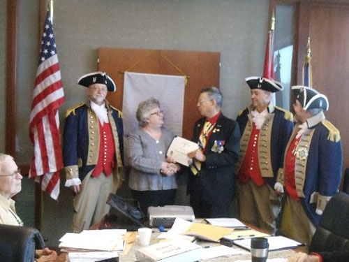 """President Robert L. Grover and the Harry S. Truman Color Guard, are shown here conducting a Certificate Presentation to guest speaker The guest speaker at the March 14, 2015 Harry S. Truman Chapter meeting was LaDene Morton.  Her topic was  on  the """"Waldo Story — Born on the Santa Fe Trails"""" at the March 14, 2015 Harry S. Truman Chapter meeting."""