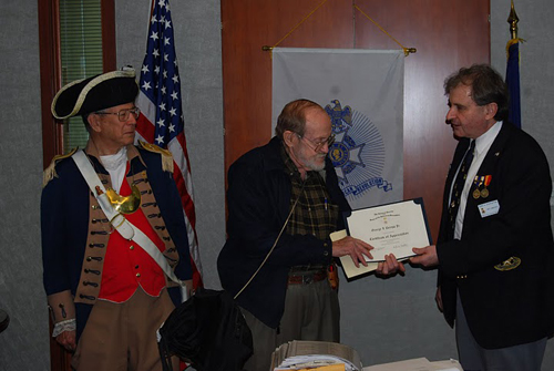 Pictured here is guest speaker, Compatriot George DeLapp, who spoke on the Carlson Raiders of the 2nd Marine Raiders Battalion during World War II on Saturday, April 9, 2011. President Dirk Stapleton presented a certificate of appreciation to Compatriot DeLapp for serving as guest speaker.