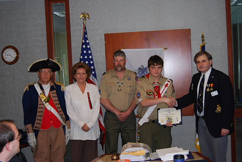 Pictured here include Eagle Scout Moss, his parents Gary and Michele Moss, and members of the Harry S. Truman Chapter who are veterans. Eagle Scout Joseph Daniel Moss was presented with his SAR certificate and SAR scouting patch by President Dirk Stapleton on April 9, 2011, for his Boy Scout Eagle Scout accomplishment.