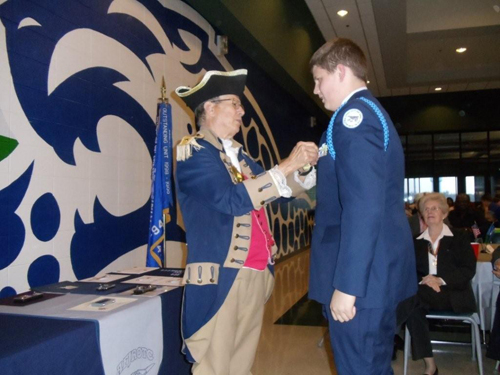 The Harry S. Truman Chapter Color Guard is shown here presenting a Junior Reserve Officer Training Corps Award to Air Force JROTC Cadet Jackson C. Chandler, at Blue Springs South High School, on Tuesday, April 26, 2011. MOSSAR Color Guard Commander Robert Grover, presented Air Force JROTC Cadet Jackson C. Chandler with the J.R.O.T.C. Award.