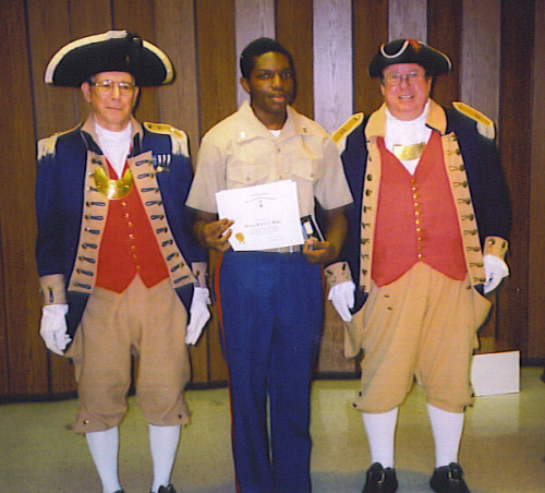 The Harry S. Truman Chapter Color Guard is shown here presenting the Junior Reserve Officer Training Corps Award to Cadet Jer' Rayle Love on May 5, 2008.