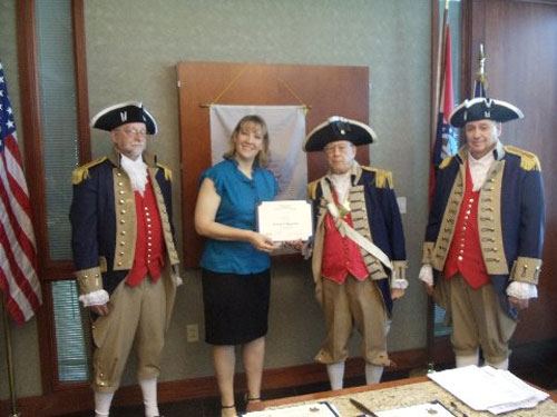 Vice-President Robert Grover and the Harry S. Truman Color Guard, are shown here presenting Dee A. Harris, who was our guest speaker at the May 10, 2014 meeting, with a Certificate of Appreciation. Dee Harris is the exhibits specialist for the National Archives at Kansas City, where she manages exhibition development. She previously served as the Director of Visual Arts and Humanities for the Mid-America Arts Alliance in Kansas City where she oversaw two national traveling exhibition programs. Harris received both her master's degree in public history and bachelor's degree in history from Wichita State University in Wichita, Kansas. Vice President Robert Grover presented Ms. Harris with a Certificate of Appreciation and a HST Chapter coin.