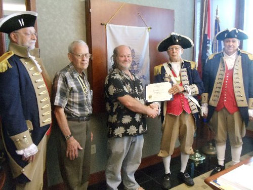 Vice-President Robert Grover and the Harry S. Truman Color Guard, are shown here conducting a New Member Induction for Compatriot Michael Curtis Loudermilk, who was inducted into the SAR for his ancestor John Hughes. Patriot John Hughes was Quartermaster Sergeant, 1st Continental Dragoons, enlisted under Capt. Lucas' Calvary, Gen. Scott's Brigade. Compatriot Loudermilk was presented with his membership certificate, membership rosette, chapter challenge coin, and welcome packet by Vice President Robert Grover and sponsor Compatriot David McCann.
