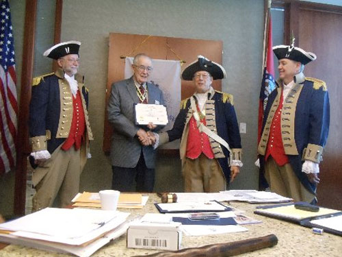 Vice-President Robert Grover and the Harry S. Truman Color Guard, are shown here presenting Compatriot Romie Carr with a certificate and medal for the SAR Korean Service Corps by Vice President Robert Grover. Congratulations Compatriot Romie Carr.