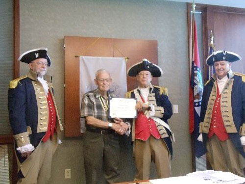 Vice-President Robert Grover and the Harry S. Truman Color Guard, are shown here presenting the Lamplighter Award to Compatriot David McCann for his donation to the Center for Advancing American Heritage.