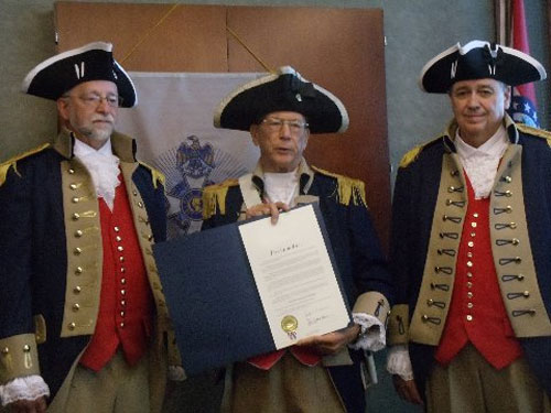 Vice-President Robert Grover and the Harry S. Truman Color Guard, are shown here with the Mayoral Proclamations received by the cities of Blue Springs and Independence declaring Sons of the American Revolution Day.