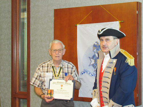 Chapter and MOSSAR State Genealogist David McCann is shown here with the Missouri State Society Gold Medal and Certificate on Saturday, May 12, 2012.  The Missouri State Society Gold Medal was presented to Genealogist McCann at the MOSSAR 122nd MOSSAR Convention on April 28,2012 in Branson, Missouri. Genealogist David McCann  is the 14th individual to receive this award.   Upon behalf of MOSSAR, the Harry S. Truman Chapter congratuates Genealogist McCann in all of his efforts as Genealogist.