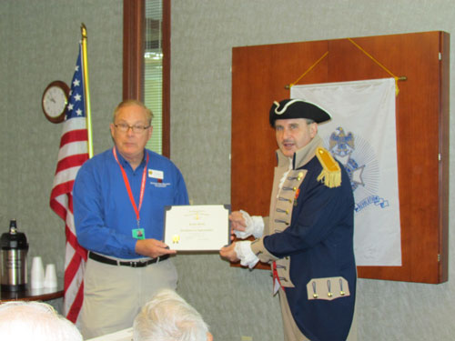 Pictured here is guest speaker, Mr. Kelton Smith, who spoke on National World War I Museum at Liberty Memorial.   The National World War I Museum at Liberty Memorial provides  exhibitions and educational programs that engage diverse audiences, and also collects preserves historical materials with the highest professional standards.  President Dirk Stapleton presented a certificate of appreciation and chapter challenge coin to Mr. Kelton Smith for serving as guest speaker.