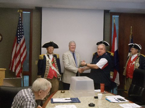 "President Donald Lewis and the Harry S. Truman Color Guard, are shown here presenting Retired U.S. Army Colonel James L. 'Spike' Speicher, who was our guest speaker at the June 14, 2014 meeting, with a Certificate of Appreciation. Colonel Speicher's topic was on: ""The Im­portance of the Valley Forge Encampment"". Colonel Speicher discussed the famous Valley Forge en­campment of 1777 - 1778. Despite disease and deprivation, the rag tag colonial rebels were turned into an army capable of standing strong."