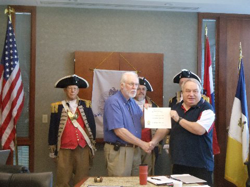 President Donald Lewis and the Harry S. Truman Color Guard, are shown here presenting Compatriot ?? with a Certificate of Appreciation.