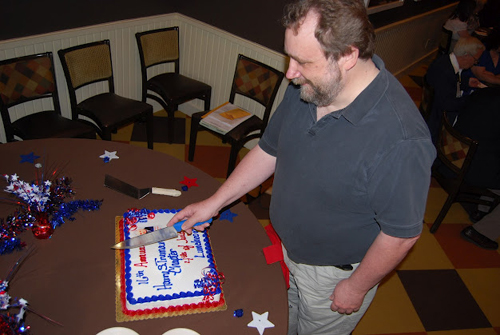 Pictured here is Thomas Barden, pending new member of the Harry S. Truman Chapter, who is shown here cutting the 16th Annual Harry S. Truman Chapter Fourth of July Luncheon cake.