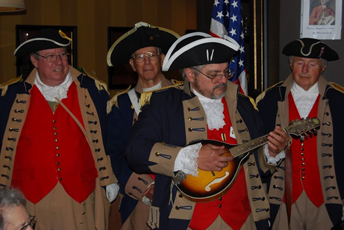 """During the closing presentation, Compatriot Perry """"Bud"""" Marks, Jr., entertained the group with his mandolin, in which he sang the traditional version of the """"Liberty Song"""" which was originally composed in 1768."""