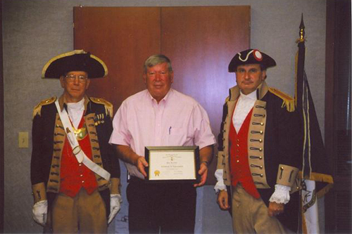 The Harry S. Truman Chapter Color Guard is shown here presenting a Certificate of Appreciation to Mayor Don Reimal of Independence, MO. Mayor Reimal, as guest speaker, received this certificate at the 277th Harry S, Truman meeting on July 12, 2008.