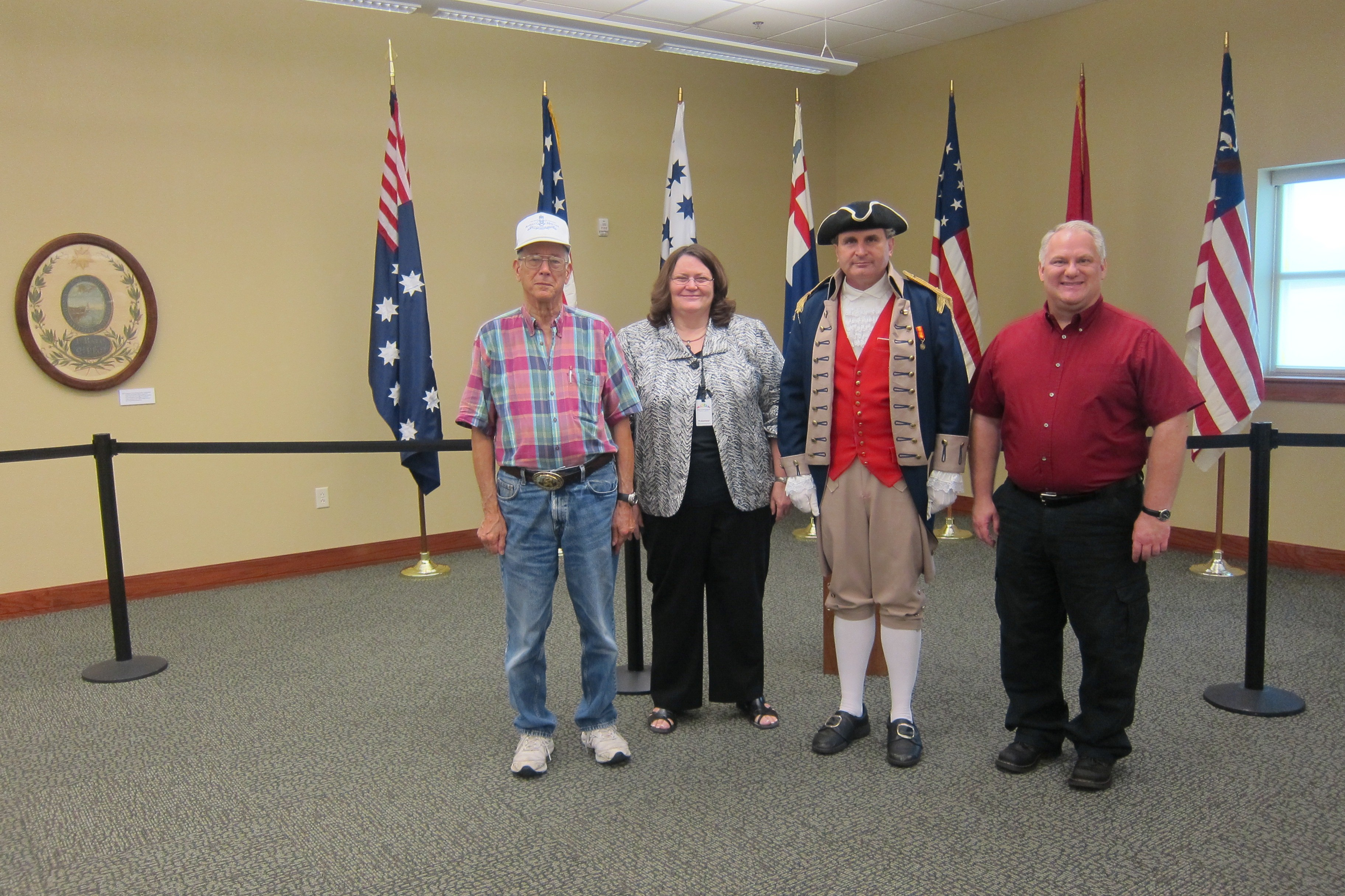 Shown here is Christine Hughes, the Harry S. Truman Color Guard Team, and other chapter  members who have volunteered as docents on Saturday, July 23, 2011. Several members of the Harry S. Truman Chapters have been appointed by the Midwest Genealogy Center, to assist with the Roots of a Nation Exhibit at the Midwest Genealogy Center in Independence, MO.