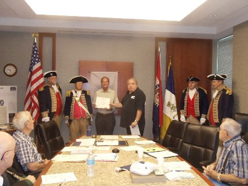 President Donald Lewis and the Harry S. Truman Color Guard, are shown here conducting a New Member Induction for Compatriot Steve Ferguson, who was inducted into the SAR for his ancestor  Patriot Benjamin Bass. Compatriot Ferguson was presented with his membership certificate, membership rosette, chapter challenge coin, and welcome packet by President Donald Lewis and sponsor Compatriot Dirk A. Stapleton.