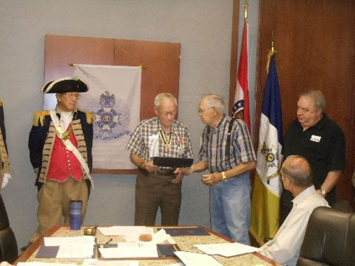 Compatriot Courtney Sloan and the Harry S. Truman Color Guard, are shown here presenting Compatriot David McCann with a certificate and a Liberty Medal (2nd bronze oak leaf cluster).