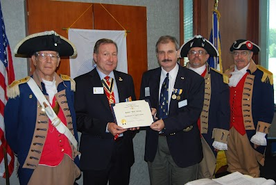Pictured here is guest speaker, Compatriot Robert Corum, President of the William C. Corum Chapter, in which he discussed the 19 American Revolutionary War patriots buried in Clay County, Missouri.  Compatriot Robert Corum is a direct descendant of Patriot William C. Corum.  President Corum offered many facts on the 19 patriots, including their contributions to the American Revolution, information on militias that they were assigned to, burial locations in Clay County, Missouri, etc.   President Dirk Stapleton presented a certificate of appreciation and a Harry S. Truman Chapter Challenge Coin to Compatriot Corum for being guest speaker.