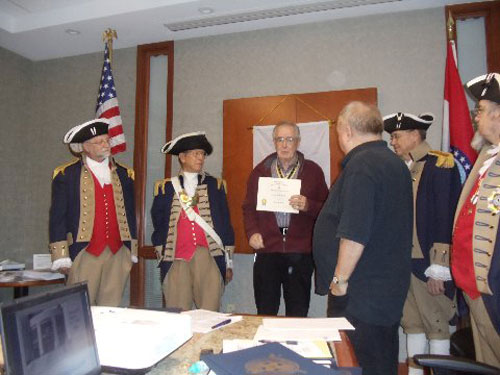 President Donald Lewis and the Harry S. Truman Color Guard, are shown here presenting a Supplemental Certificate to Compatriot Romie Carr, for his ancestor  ??? John Hughes. ???Patriot John Hughes was Quartermaster Sergeant, 1st Continental Dragoons, enlisted under Capt. Lucas' Calvary, Gen. Scott's Brigade.