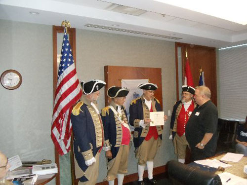 President Donald Lewis and the Harry S. Truman Color Guard, are shown here presenting a Supplemental Certificate to Compatriot Roy Hutchinson, for his ancestor John Waddell. Patriot John Waddell signed the Watauqa Association on July 5, 1776.