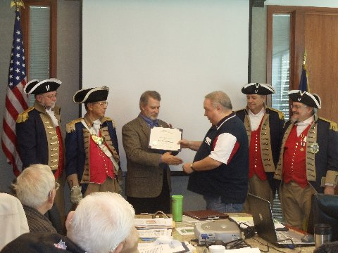 """President Donald Lewis and the Harry S. Truman Color Guard, are shown here presenting Thomas """"Brooks"""" Lyles, Jr., who was our guest speaker at the November 9, 2013 meeting, with a Certificate of Appreciation. Compatriot Lyles spoke on the Battle of Princeton."""