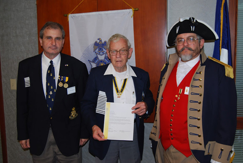 The Harry S. Truman Chapter Color Guard is shown here along with Compatriot David McCann, and President Dirk Stapleton, during a recogingition cremony. The ceremony recognizes Compatriot McCann for his pledge to support the Sons of the American Revolution Foundation and the Center for Advancing America's Heritage Campaign (CAAH)