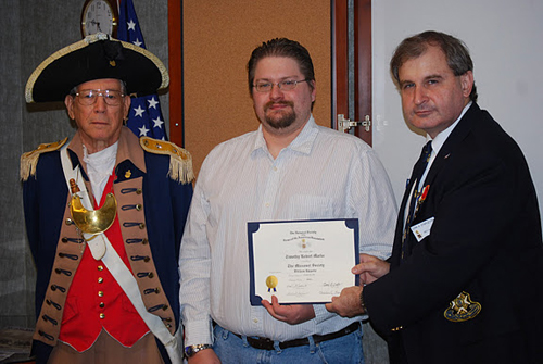 "The Harry S. Truman Chapter inducted Compatriot Timothy Robert Marks into the ranks at the 317th Meeting on Saturday, November 12, 2011. President Dirk A. Stapleton and the Harry S. Truman Chapter Color Guard officiated during the ceremony. President Dirk Stapleton presented Compatriot Timothy Marks with his membership oath and membership certificate.  Timothy's father, Compatriot Perry Dean ""Bud"" Marks, also participated in the ceremony."
