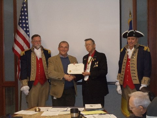 Vice-President Robert L. Grover and the Harry S. Truman Color Guard, are shown here presenting Mr. Steve Noll, who was our guest speaker at the December 14, 2013 meeting, with a Certificate of Appreciation. Mr. Boll spoke on the Jackson County Court House.