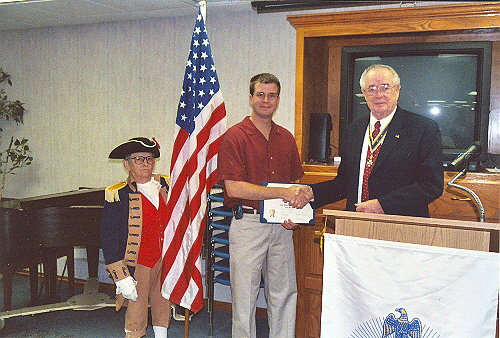 President Romie Carr and Color Guard member William Hartman are shown here welcoming Justin Scott Bush as a new member to the MOSSAR Harry S. Truman Chapter at the July 8th, 2006 meeting