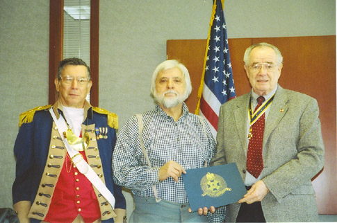 Harry S. Truman Chapter President Romie E. Carr and Major General Robert L. Grover, Harry S. Truman Chapter Color Guard Commander, is shown here during the presentation of a Certificate of Appreciation to guest speaker Jim Beckner. Jim Beckner provided a Civil War presentation on clothing, gear and weapons on Saturday, February 10, 2007. .