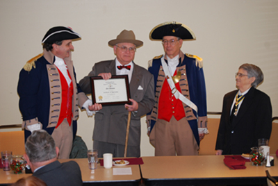 Pictured here is Harry S. Truman Chapter President William Hartman, the Harry S. Truman Chapter Color Guard, and Mr. Neil Johnson of Independence, Missouri who are shown here at the December 13th 2008 meeting.   Mr. Johnson, a Harry S. Truman impersonator, provided a very interesting presentation and overview on the life and times of Harry S. Truman.   Mr. Johnson portrayed the 33rd President of the United States, telling about anecdotes on Harry's life, and wise sayings that Harry made.