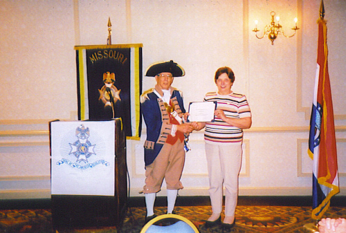 """The Molly Pitcher Award is a new Award for Missouri Women called """"Molly Pitcher"""". The First awardee is Carolyn S. Grover. Major General Robert L. Grover, MOSSAR Color Guard Commander, is shown here presenting the Molly Pitcher Award to Carolyn S. Grover, wife of Robert L. Grover, Harry S. Truman Chapter, with a separate Molly Pitcher certificate on April 25, 2009."""