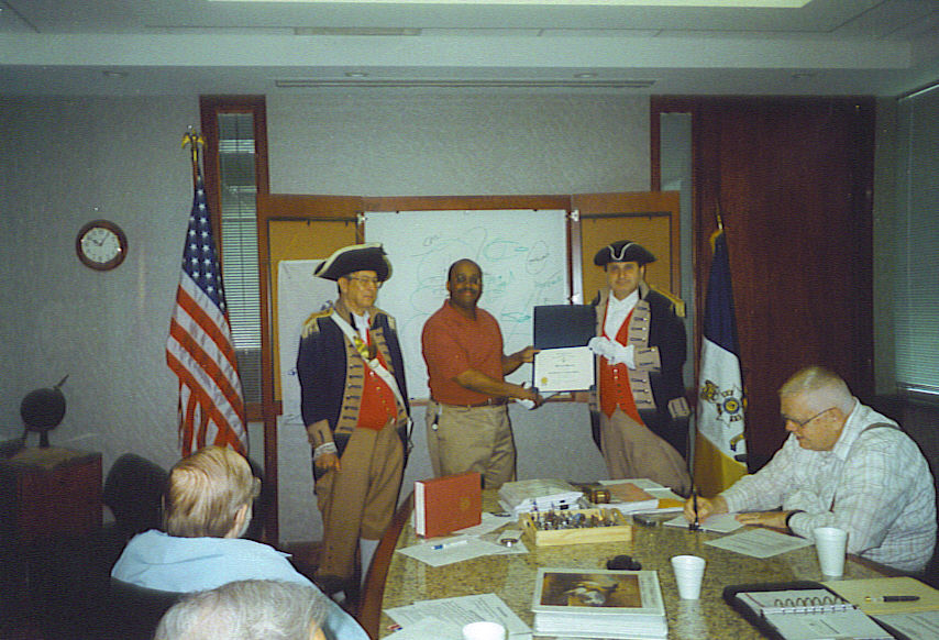 Pictured here is the Harry S. Truman Color Guard and Lieutenant Colonel Bernard Harris, U.S. Army, (Retired).  LTC Harris, a U.S. Army Engineer, has been a Revolutionary War reenactor since 1989. He has a deep interest in miltary history.  He spoke on army sustainment, logistics and money as a weapon during the Revolutionary War. He spoke about the Revolutionary War being divided into three theaters, North, Middle [Geo Washington], and South [Gen. Nathaniel Green].