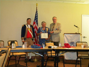 Pictured here is guest speaker Mary Lynn Tolle receiving the SAR Medal of Appreciation from Compatriot Romie Carr and Vice President General of NSSAR - South Central District, Robert L. Grover.