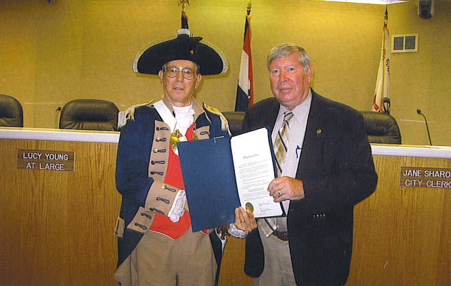 Pictured here is Harry S. Truman Chapter Member Robert L. Grover along with Independence Mayor Don Reimal after signing the 25 Year Proclamation for MOSSAR Harry S. Truman Chapter.