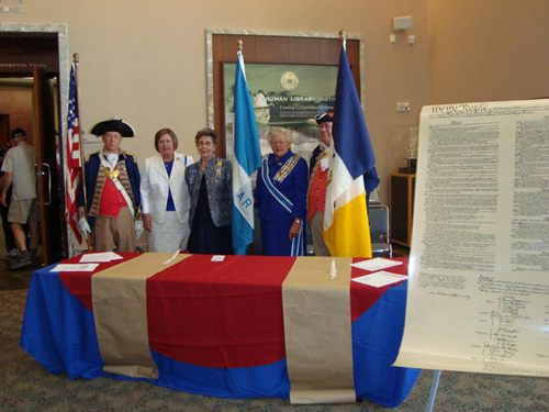 The Harry S. Truman Color Guard and Missouri DAR members participated in a U. S. Naturalization Ceremony, hosted at the Harry S.Truman Library, in Independence, Missouri on Thursday, September 17, 2009.  The Color Guard Commander, Major General Robert Grover and Captain James L. Scott, are shown here with Mary Lynn Tolle, Honorary State Regent, Missouri and Vice President General NSDAR and other area DAR members, during Constitution Week 2009.