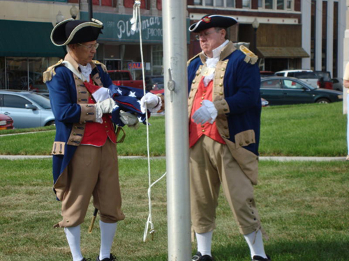 Sons of the American Revolution Color Guard members Major General Robert L. Grover, MOSSAR Color Guard Commander and Captain James L. Scott are shown here preparing to raise the U.S. Flag, donated by the Independence Pioneers Chapter Daughters Chapter of the American Revolution during the dedication ceremony held on September 18, 2009.