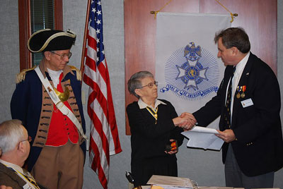 The Harry S. Truman Chapter awarded two Compatriots for their tireless efforts at both the Chapter and State of Missouri level.  Compatriot William Hartman is shown here with Chapter President Dirk A. Stapleton and MOSSAR Color Guard Commander Robert L. Grover, after receiving the Silver MOSSAR award