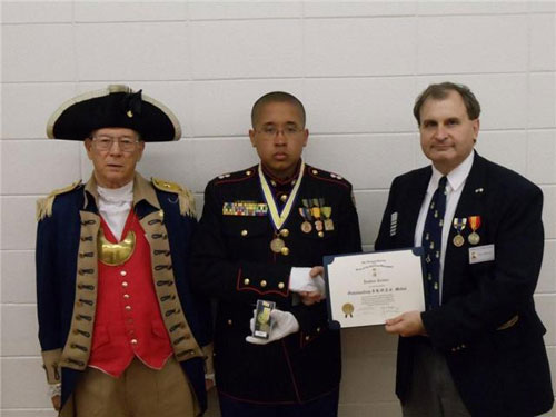 The Harry S. Truman Chapter Color Guard is shown here presenting the Junior Reserve Officer Training Corps Award to Cadet First Lieutenant Joshua Keever, along with a $50.00 check, at the Hickman Mills awards night, on Tuesday, May 11, 2010 at 6:30 P.M. in the Hickman Mills High School Cafeteria. President Dirk Stapleton, from the Harry S. Truman Chapter, along with Color Guard Commander Robert Grover, presented Cadet First Lieutenant Keever with the Enhanced J.R.O.T.C. Award.