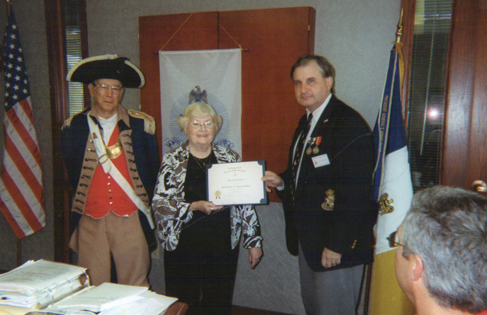 Harry S. Truman Chapter President Dirk Stapleton, the Harry S. Truman Chapter Color Guard, and  Mrs. Marilyn Feaster of Lee's Summit, Missouri,  are shown here at the June 12th, 2010 meeting. Mrs. Feaster is shown here receiving a Certificate of Appreciation and a Harry S. Truman Chapter coin.