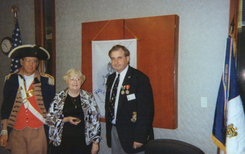Harry S. Truman Chapter President Dirk Stapleton, the Harry S. Truman Chapter Color Guard, and  Mrs. Marilyn Feaster of Lee's Summit, Missouri,  are shown here at the June 12th, 2010 meeting. Mrs. Feaster is shown here receiving a Harry S. Truman Chapter coin.