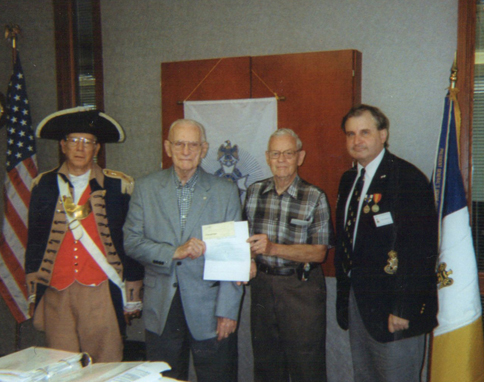 The Harry S. Truman Chapter Color Guard is shown here along with Compatriot Harry Dexheimer, Compatriot David McCann, and President Dirk Stapleton, during a recogingition cremony. The ceremony recognizes both Compatriot Dexheimer and Compatriot McCann for their pledge to support the Sons of the American Revolution Foundation and the Center for Advancing America's Heritage Campaign (CAAH).