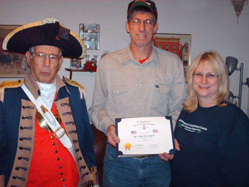Pictured here is a Flag Certificate Award being presented on December 16, 2010 to John and Janice Lawton of Blue Springs, MO. Major General Robert L. Grover, MOSSAR Color Guard Commander is shown here conducting a Flag Certificate Award presentation. Harry S. Truman Chapter member Dale Edwards also participated in the presentation.