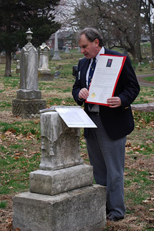 President Dirk A. Stapleton, President of the Harry S. Truman Chapter, is shown here reading a Proclamation signed by Kansas City Mayor Mark Funkhouser during a recognition ceremony for a Civil War Medal of Honor recipient, Private Nathaniel Gwynne, buried at Kansas City's Union Cemetery.  The ceremony was conducted on National Medal of Honor Day, 25 March 2011.